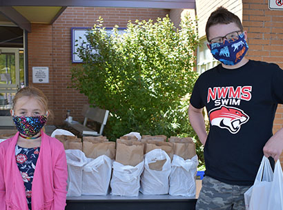 Two students receive meals.