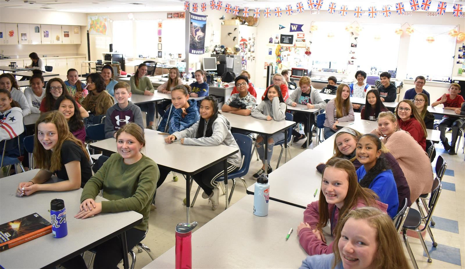 The NJHS students smile in the classroom.