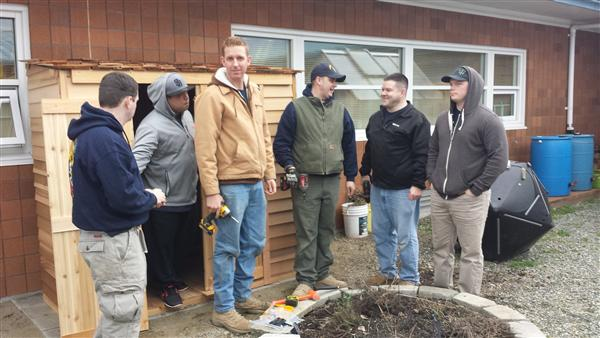 Navy Volunteers Building Garden Shed