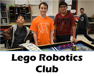 Three students stand in front of lego display table
