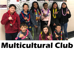 Students of the multicultural club display their Hawaiian Leis in front of the club bulletin board.