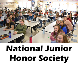The students of the NJHS smile in the classroom.