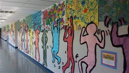 Photo of Hillcrest Hallway Decorated with student artwork inspired by Keith Haring