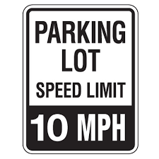 Sign stating 10 mph speed limit in parking lot