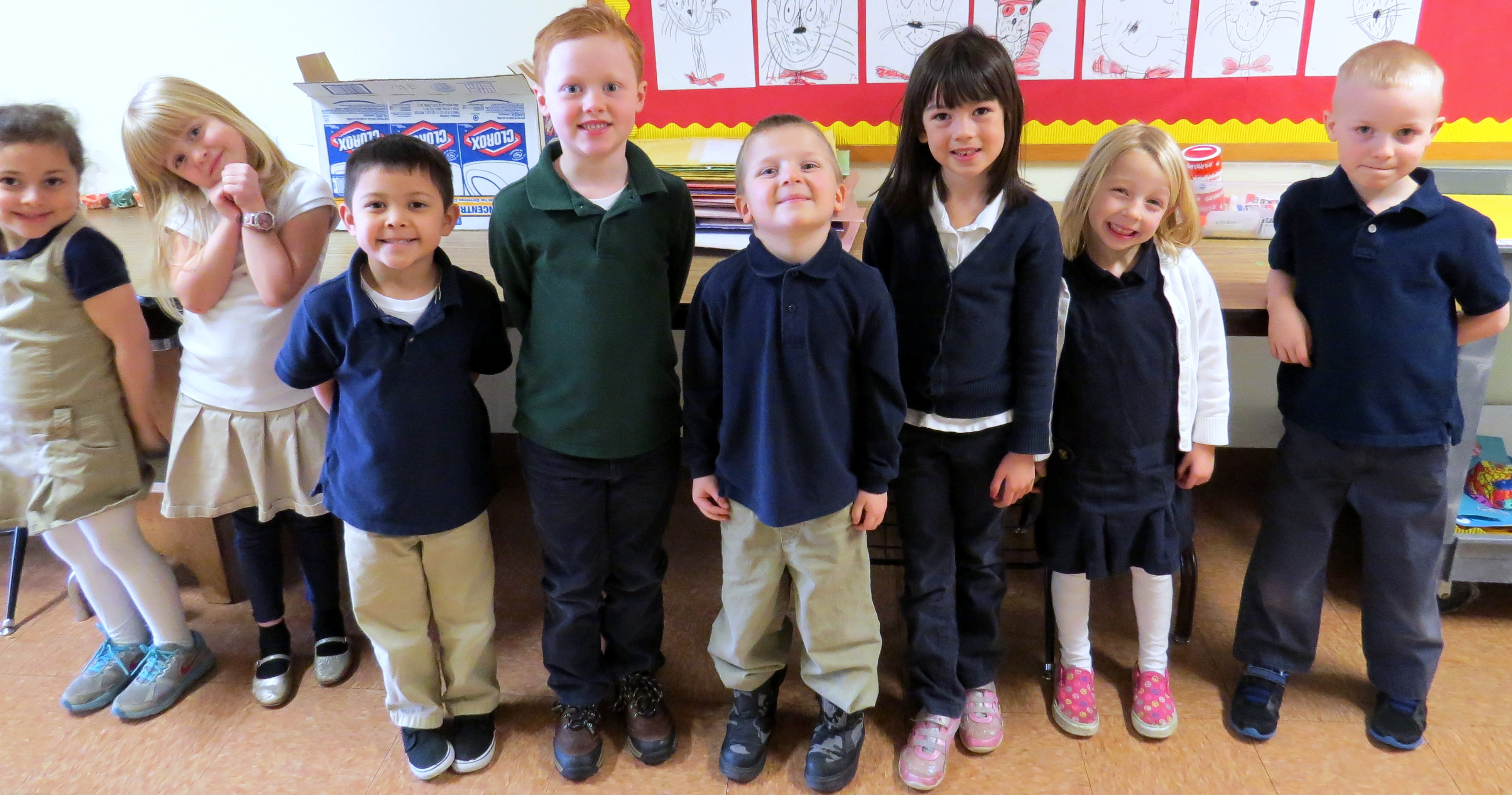 Smiling kids wearing school uniforms