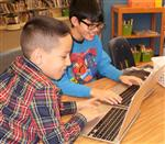 Students learn technology skills in the library.