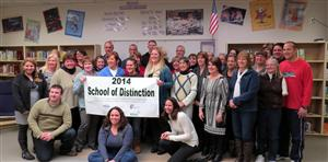 Faculty and Staff with banner