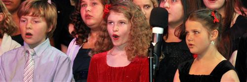 Students singing at a concert