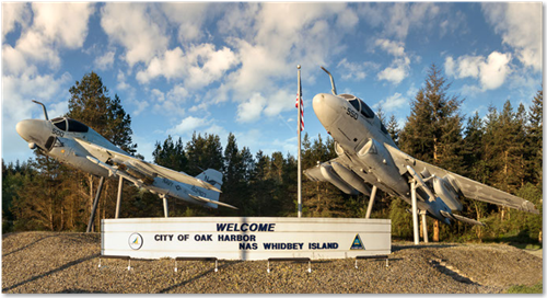 navy jets above nas whidbey sign