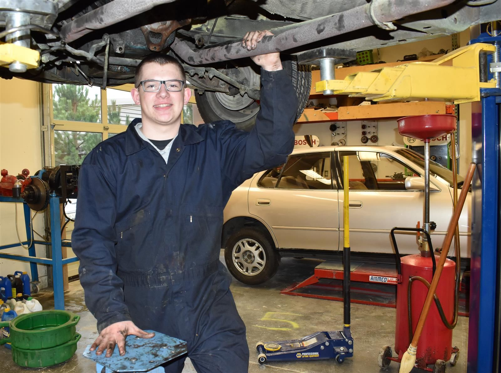 Student working on a car